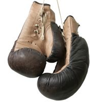 Old boxing gloves hanging on a lace - hoboton - Fotolia.com